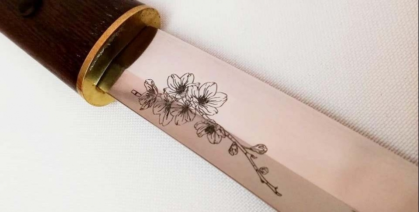 Гравировка на клинке или элементах меча